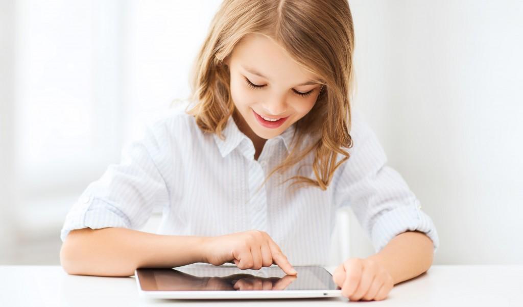 girl in school uniform on tablet