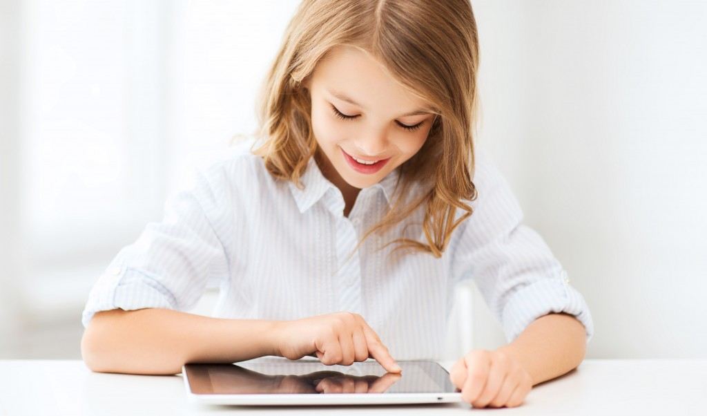 girl in school uniform on tablet